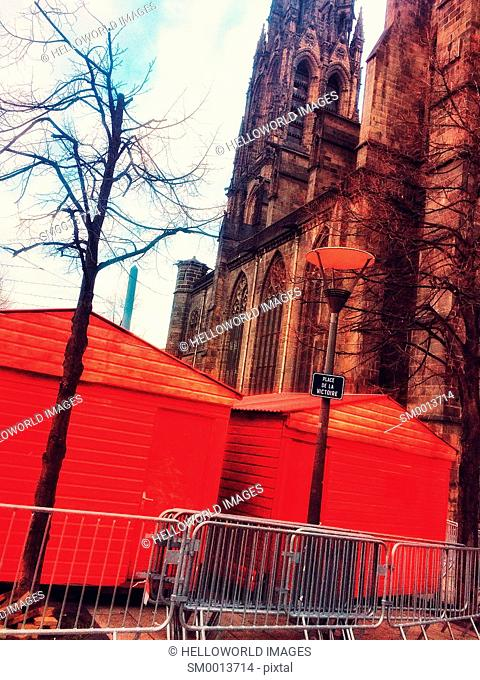 Red Christmas market huts and cathedral, Place de la Victoire, Clermont Ferrand, Auvergne, France, Europe