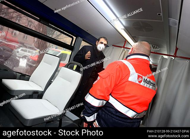 28 January 2021, Bavaria, Memmingen: Klaus Holetschek (CSU), Bavarian Minister of Health, stands in a vaccination bus with an employee of the aid organisation...