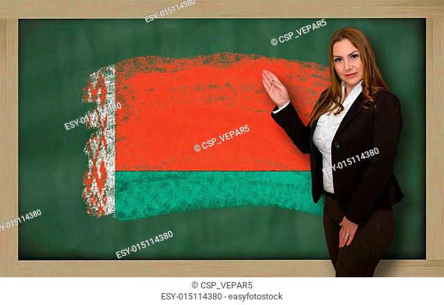 Successful, beautiful and confident woman showing flag of belarus on blackboard for marketing research, presentation and tourist advertising