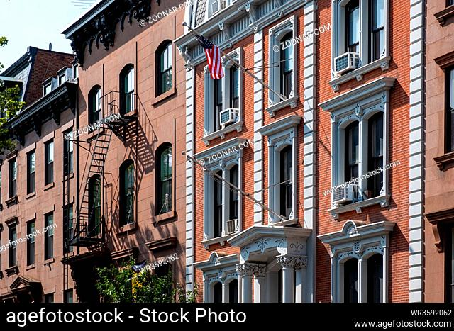 Brooklyn NY - USA - Jul 9 2019: Street scene and apartment buildings of Brooklyn Heights in summer sunny daylight