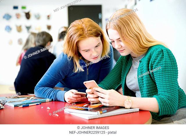 Teenage girls using Smartphone