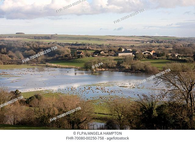 View of flooded fields around river, River Adur, Arun Valley, Amberley, West Sussex, England, February 2014