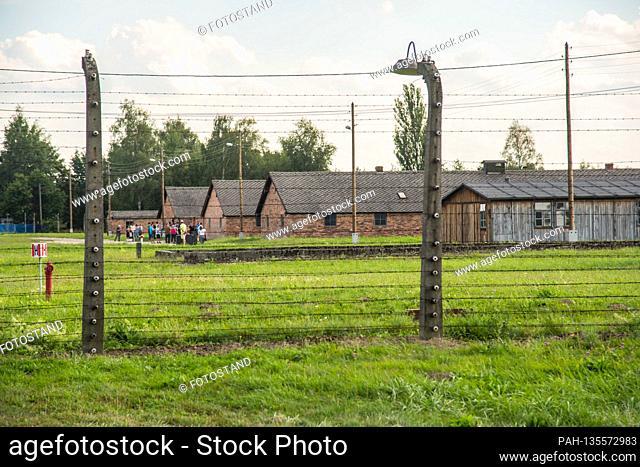 Auschwitz, Poland August 25, 2020: Auschwitz-Birkenau concentration camp - August 25, 2020 barracks, barriers, barbed wire, exterior view,   usage worldwide
