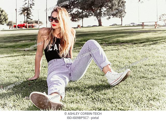 Hip young woman relaxing in park