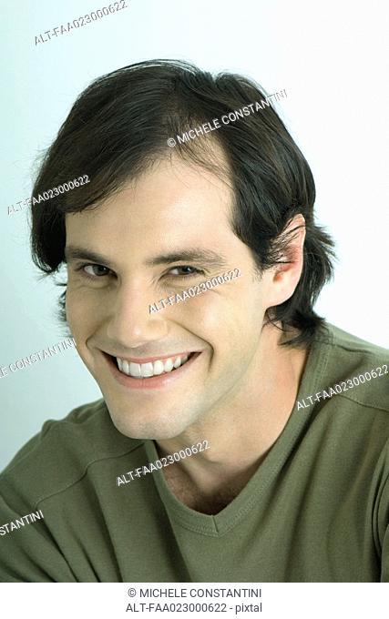 Man, smiling at camera, portrait