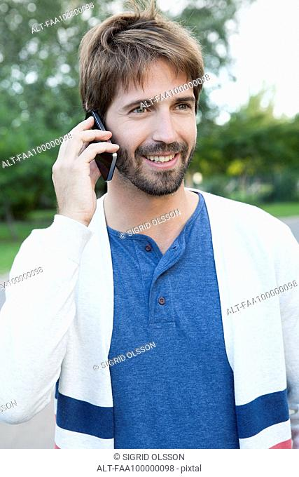 Man using smartphone outdoors