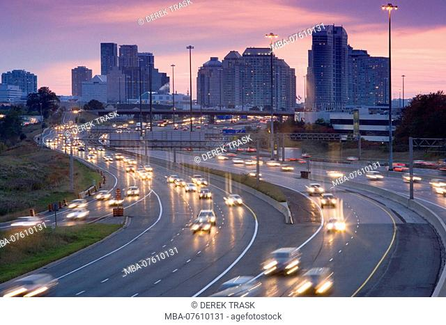 North America, Canada, Ontario, Toronto, traffic on highway 401 at dusk, one of busiest highways in world