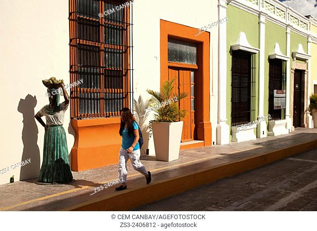 Street scene with statue in the foreground from the historic center of Campeche, Campeche Region, Yucatan, Mexico, Central America