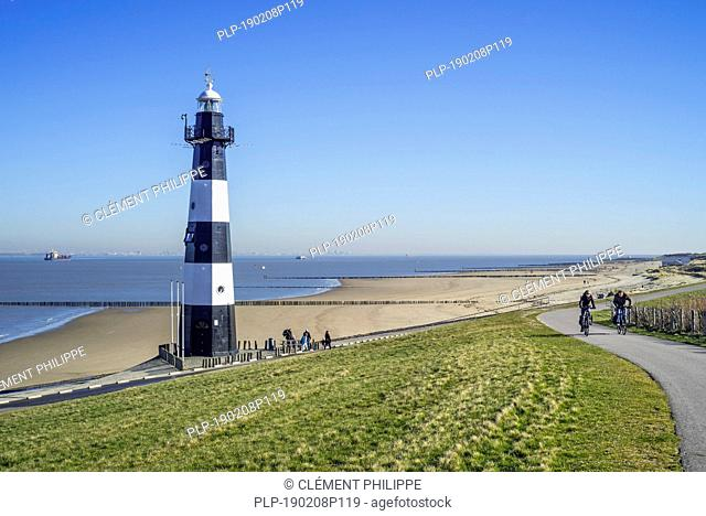 Levee / dike and Nieuwe Sluis, lighthouse near Breskens which marks the entrance to the Western Scheldt / Westerschelde, Zeeland, the Netherlands