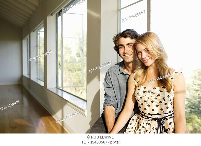 Portrait of young couple in empty home
