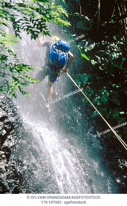 Canyoning in a waterfall