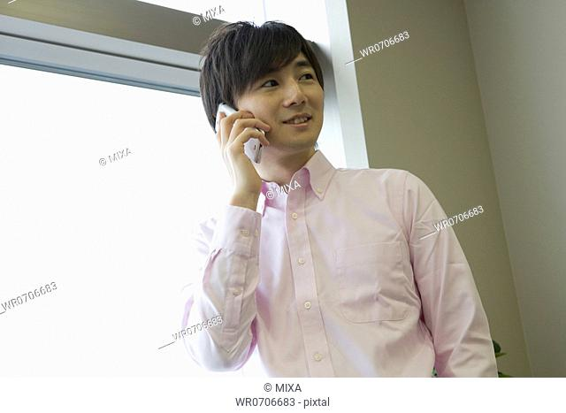 Businessman holding smartphone at office