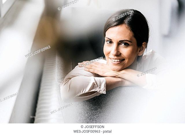 Portrait of smiling woman on couch