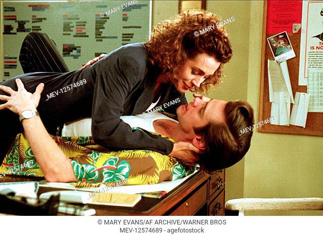 Sean Young & Jim Carrey Characters: Lt. Lois Einhorn, Ace Ventura Film: Ace Ventura: Pet Detective (1994) Director: Tom Shadyac 04 February 1994