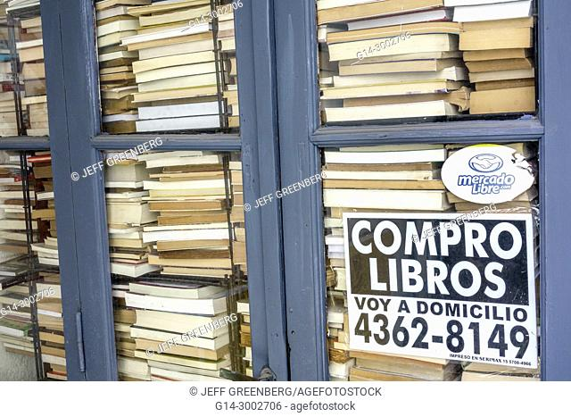 Argentina, Buenos Aires, San Telmo, historic center, Galeria del Viejo Hotel, shopping arcade, used books, stacked, sign, buy books, free pick-up