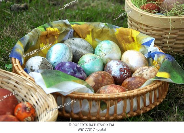 Painted eggs at Easter. Easter eggs in basket on green grass