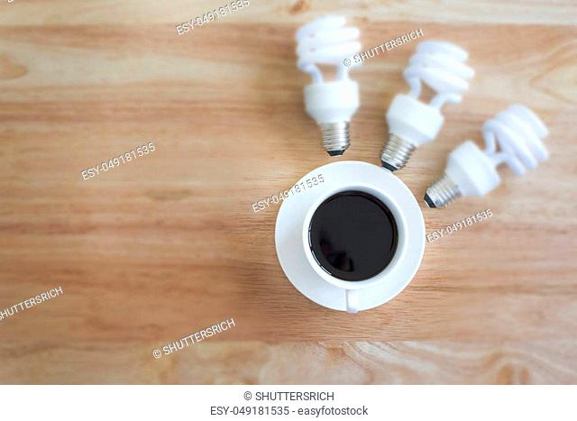 Brainstormneed the power. Black Coffee Mug in selective focus on a Wooden Table is the best for creat new project