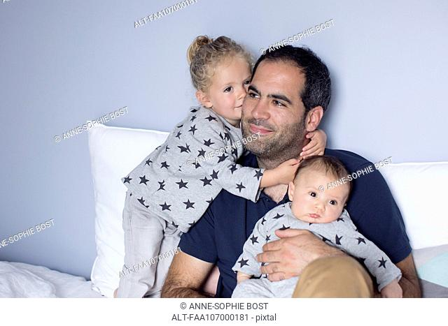 Father with baby boy and young daughter