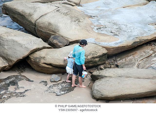 Mother & daughter beachcombing at Caloundra, Sunshine Coast, Queensland, Australia