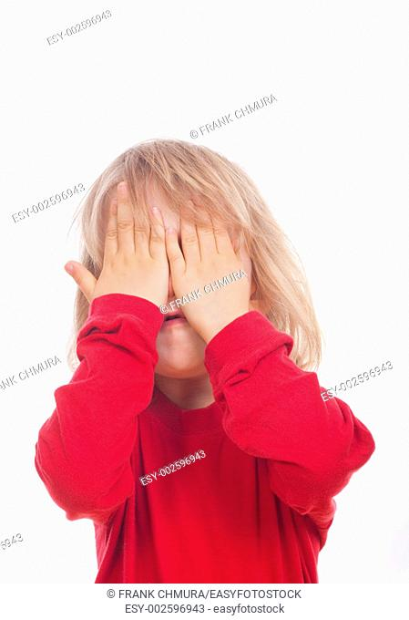 portrait of a boy in red covering his face with hands - isolated on white