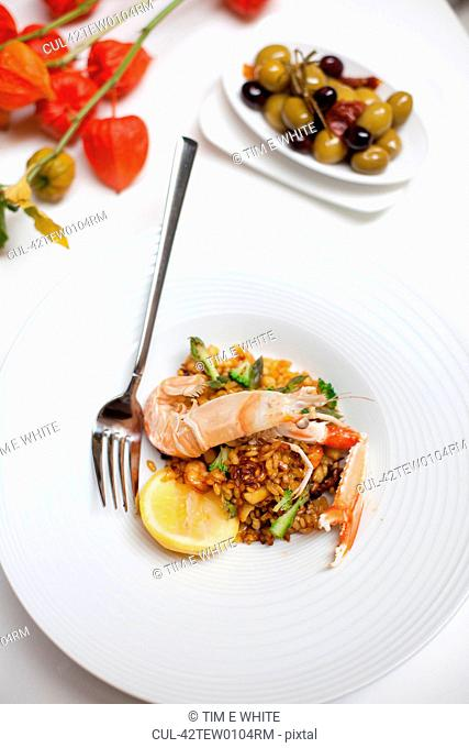 Plate of langoustine paella with olives
