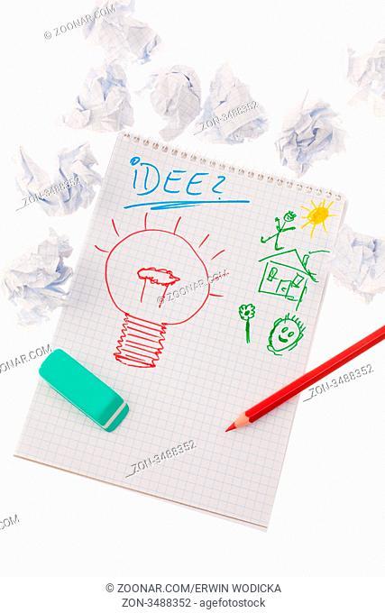 Glühbirne auf Zeichnung als Symbol für neue Ideen