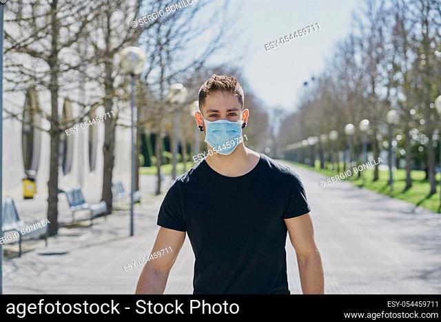 Caucasian male with medical masks as a defense against a virus. Coronavirus concept