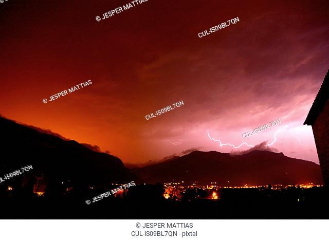 Lightning over Tramuntana mountains, Soller in foreground, Biniaraix, Mallorca, Spain