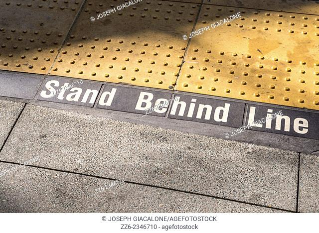 Stand Behind Line warning sign at a trolley station. San Diego, California, United States