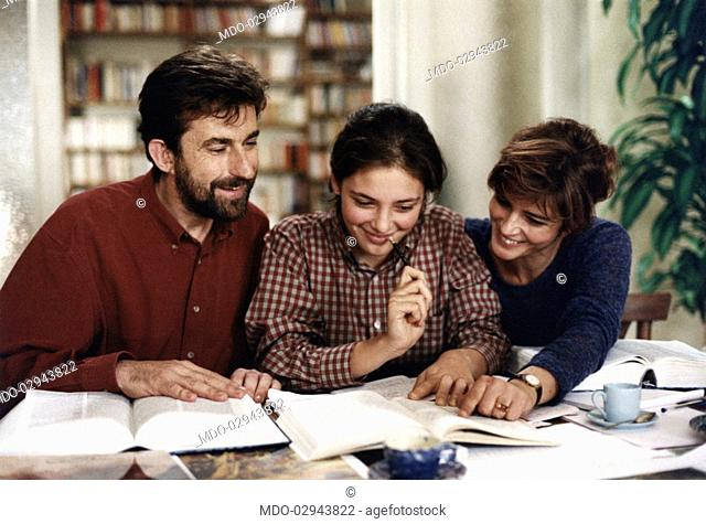 Italian actor and director Nanni Moretti smiling with Italian actresses Jasmine Trinca and Laura Morante in The Son's Room. Ancona, 2001
