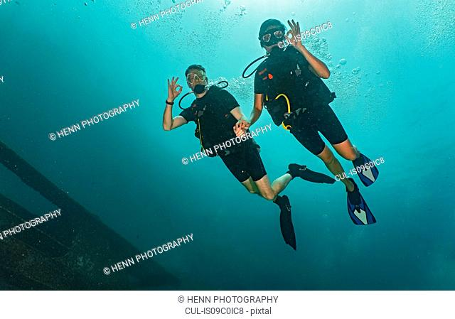 Couple divers showing ok sign, Ko Racha Yai, Rawai, Phuket, Thailand