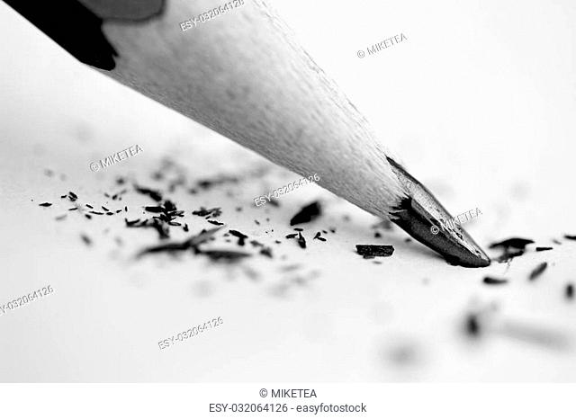 A black and white macro shot of pencil lead against paper