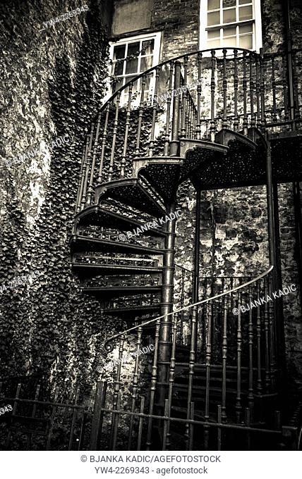 Wrought iron spiral staircase and house covered with ivy, Oxford, England, UK