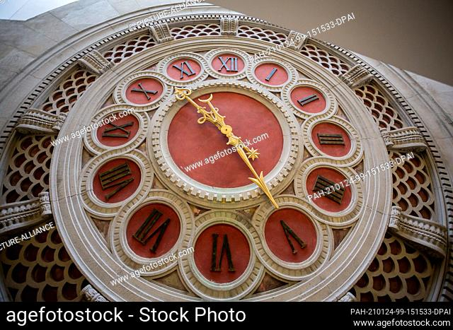 20 January 2021, Berlin: The restored old reading room clock is located behind the stairs of the open stacks of the Staatsbibliothek Unter den Linden