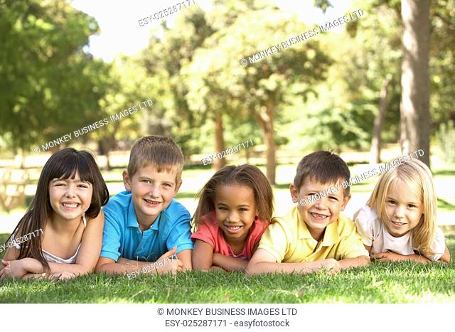 Group Of Children Laying In Park