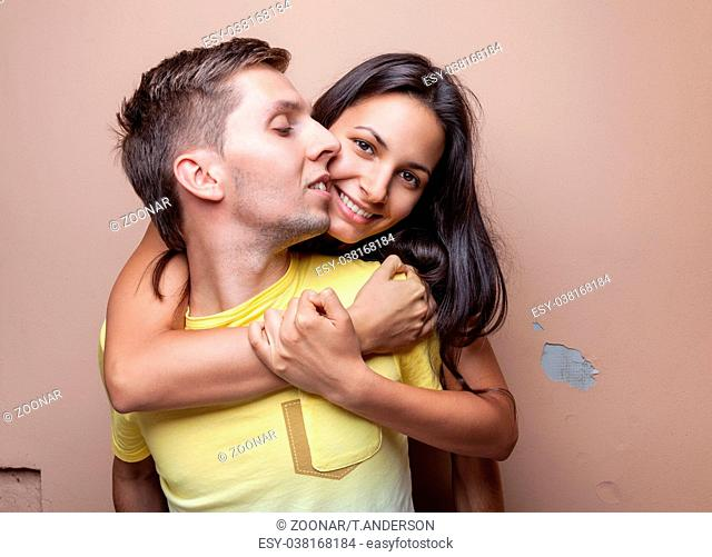 Young happy smiling couple in love embracing