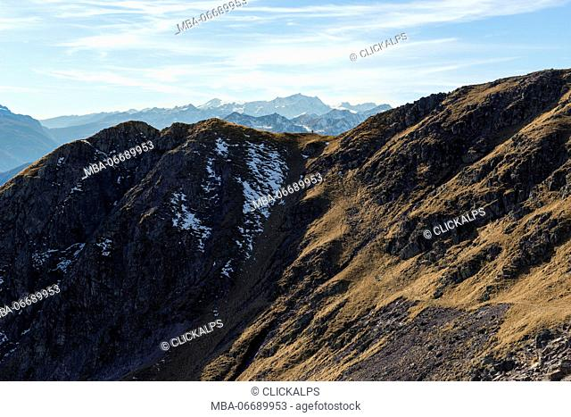 Italy, Trentino Alto Adige, Non valley, hiker on Luco Mount, in the background you see Brenta group
