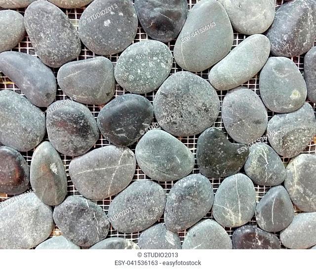 gray sea pebble stone wall texture background