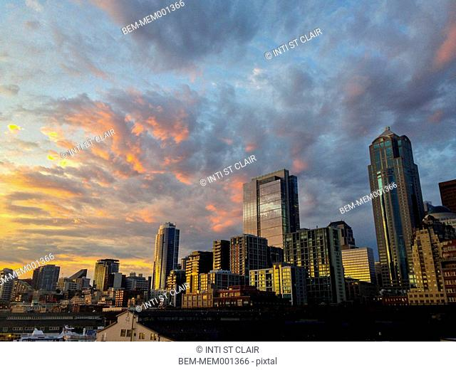 Sun setting over Seattle city skyline, Washington, United States