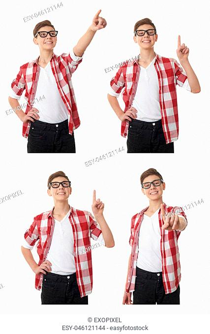 Cute teenager boy in red checkered shirt and glasses pointing up side over white isolated background, half body