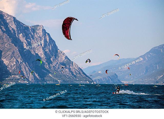 Garda Lake, Lombardia, Italy. Kite surfers enjoyng themselves on the Garda lake