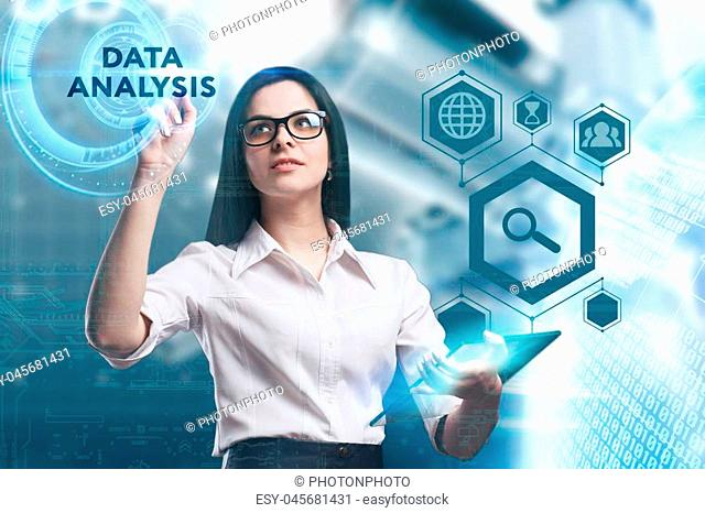 The concept of business, technology, the Internet and the network. A young entrepreneur working on a virtual screen of the future and sees the inscription: Data...