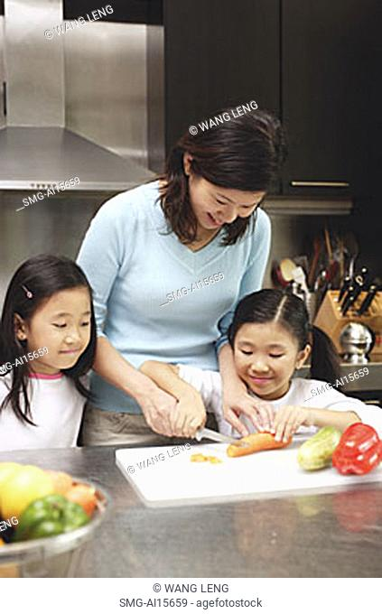 Mother with two daughters in kitchen