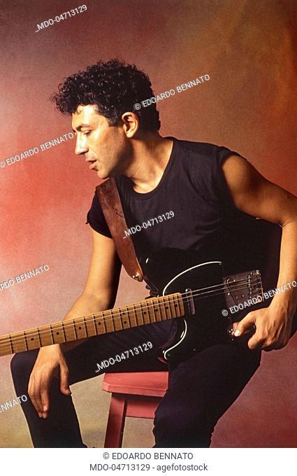 The singer-songwriter Edoardo Bennato with his guitar. Italy, 1985