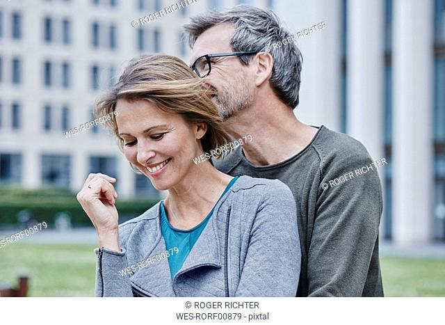 Smiling mature couple hugging outdoors