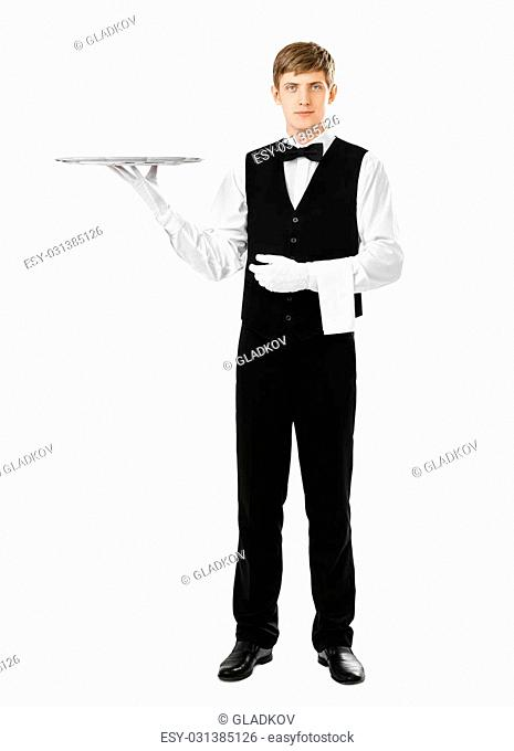 Full length portrait of handsome elegant waiter holding empty silver tray isolated on white background