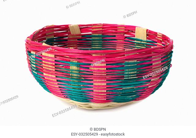 Colorful bamboo basket over white background
