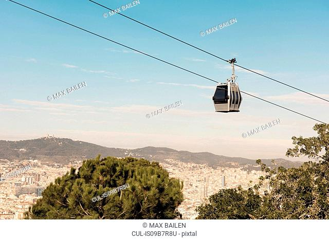 Elevated view of cityscape and cable car, Barcelona, Spain