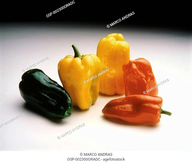 colorful red green and yellow peppers seasonings