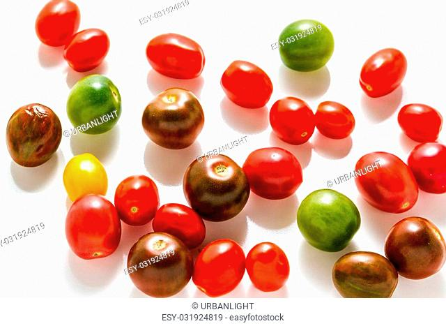 Multicolored cherry tomatoes picked from organic garden